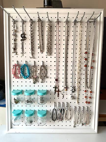 Jewelry on Pegboard Hooks
